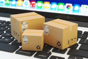 Internet shopping, online purchase, e-commerce and packages delivery concept, merchandise cardboard boxes on laptop keyboard