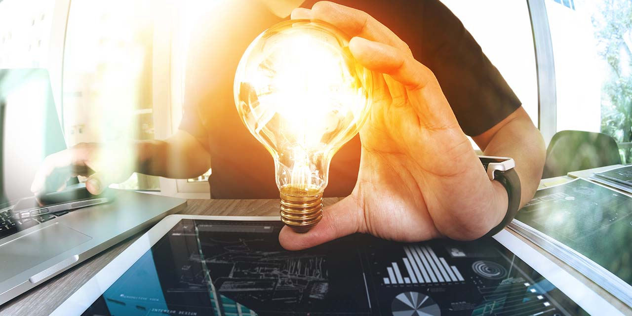 designer hand showing creative business strategy with light bulb as concept  ; Shutterstock ID 387613528